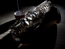 Saxophone cigarette and old sheet music Royalty Free Stock Photo