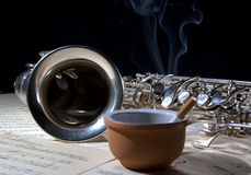 Saxophone cigarette and old sheet music Stock Images