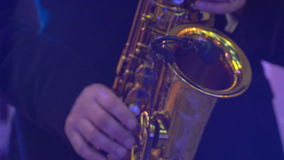 Saxophone classical music instrument Saxophonist with alto sax. Closeup on black stock video footage