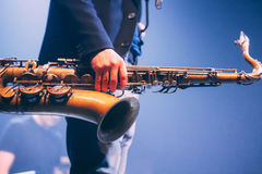 Saxophone cllose up. Saxophone close up in hands, music show detail Stock Photography
