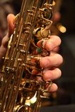 Saxophone close up of hand playing keys royalty free stock images
