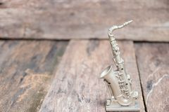Saxophone for decorate old close up on vintage wooden background with copy space add text.  Stock Images