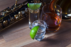 Saxophone and drinks Royalty Free Stock Images