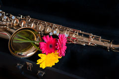 Saxophone with flower Stock Images
