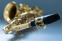 Saxophone. On the gray background Royalty Free Stock Photography