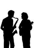 Saxophone and guitar Stock Image
