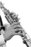 Saxophone in the hands of a musician of a closeup in black and white Stock Photo