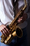 Saxophone with Hands Playing Royalty Free Stock Photography