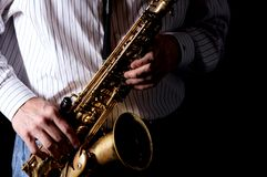 Saxophone with Hands Playing Stock Photo