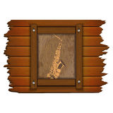 Saxophone image on a wooden board in frame uno Royalty Free Stock Image