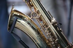 Saxophone instrument. Side view of brass musical saxophone instrument Royalty Free Stock Images