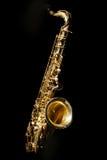 Saxophone isolated on black background Royalty Free Stock Photo