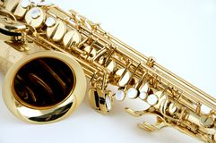 Saxophone Isolated Closeup. An alto saxophone isolated closeup against a high key white background in the horizontal view Stock Images