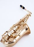 Saxophone Isolated On White Bk. An alto saxophone isolated against a hig key white vertical or portrait view Stock Image