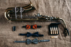Saxophone, mouthpieces and bowtie, sack background Royalty Free Stock Image