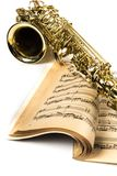 Saxophone On Music Notes Book Close-up. Alto band blue brass closeup detail gold Stock Image