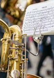 Saxophone and musical score Royalty Free Stock Photos