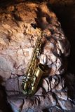 Saxophone and old rock Royalty Free Stock Photography