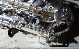 Saxophone and old Sheet music Stock Photography