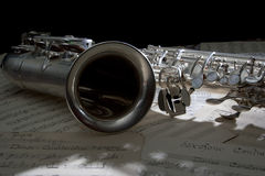 Saxophone and old Sheet music. Saxophone with a old sheet music Royalty Free Stock Images