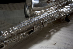 Saxophone and old Sheet music. Saxophone with a old sheet music Stock Photography