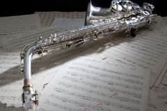 Saxophone and old Sheet music. Saxophone with a old sheet music Stock Photo