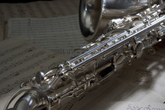 Saxophone and old Sheet music. Saxophone with a old sheet music Royalty Free Stock Photography