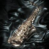 Saxophone over velvet. Alto saxophone over velvet, low-key photograph Royalty Free Stock Image