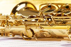 Saxophone part with musical notes reflecting on it Royalty Free Stock Photo