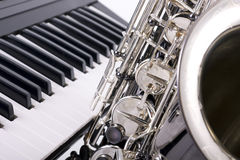 Saxophone and piano keys Stock Photography