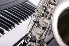 Saxophone and piano keys stock photography