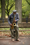 Saxophone Player. NEW YORK CITY - OCTOBER 9: A saxaphonist busking in Central Park's Bethesda Terrace, a popular tourist attraction October 9, 2012 in New York Stock Photography