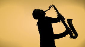Saxophone player in a color background stock video