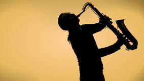 Saxophone player in a color background stock footage