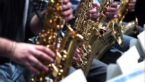 Saxophone player jazz music. Instrument Saxophonist with sax closeup on focusless background stock video footage