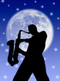 Saxophone player in the moon Royalty Free Stock Images