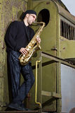Saxophone player outdoors Royalty Free Stock Photo