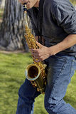 Saxophone Player in the park Stock Photos