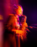 Saxophone player performing on stage Stock Photo