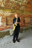 Saxophone player performing under Central Park bridge in Manhattan Royalty Free Stock Images