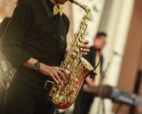 Saxophone Player Plays his Instrument. The saxophone player plays his instrument Royalty Free Stock Image