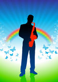 Saxophone player on rainbow background Royalty Free Stock Images