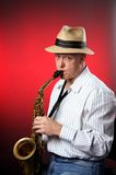 Saxophone Player on Red Stock Images