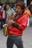 Saxophone Player. A 1970s retro brass band was part of the Weimar Art Festival in August of 2014. The city of Weimar in the federal state of Thuringia, Germany Royalty Free Stock Photo