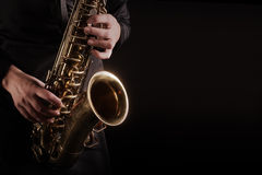 Saxophone Player Saxophonist playing jazz music. Sax alto Jazz Musician hands closeup Stock Photography