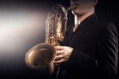 Saxophone player Saxophonist playing jazz sax baritone stock photo