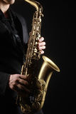 Saxophone. Classical music instruments Saxophonist with alto sax closeup on black Royalty Free Stock Images