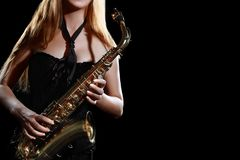 Saxophone player. Saxophonist woman with sax stock photo