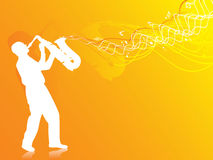 Saxophone player silhouette in the orange lights Stock Image