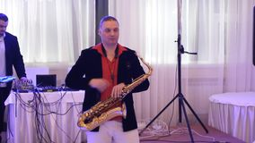 Saxophone player and sound engineer at work stock footage